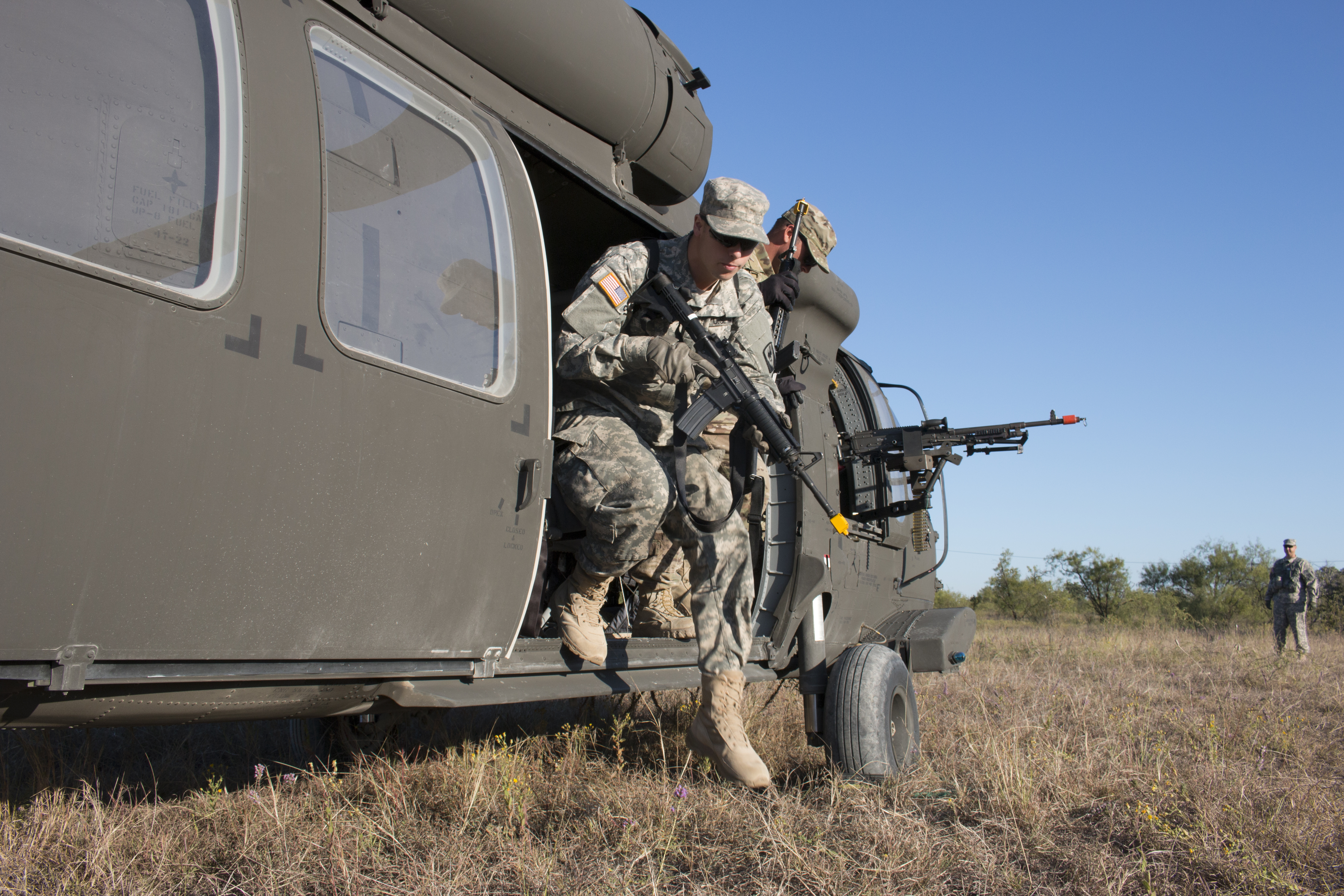 """""""Soldiers from the California Army National Guard 1st Battalion, 140th Aviation Regiment, 40th Combat Aviation Brigade hit the ground running during a small unit tactics exercise at Fort Hood, Texas, Oct. 19, 2015."""""""