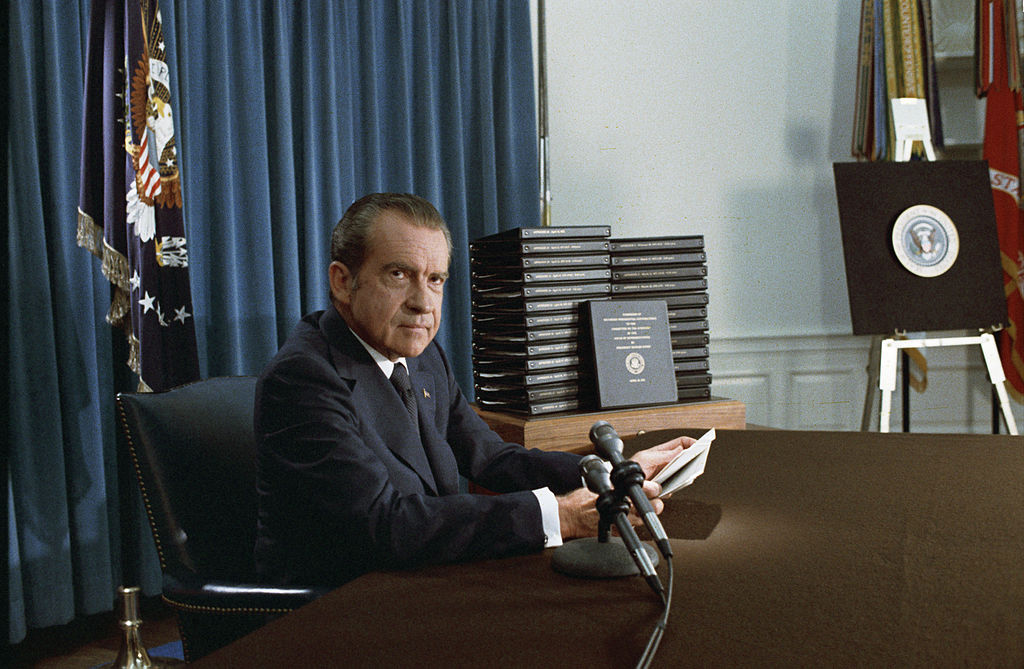 Nixon with edited transcripts of Nixon White House Tape