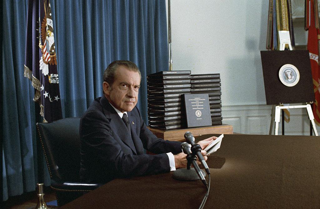 Nixon with edited transcripts of Nixon White House Tape
