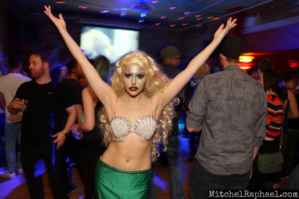 Courtney Conquers in mermaid drag