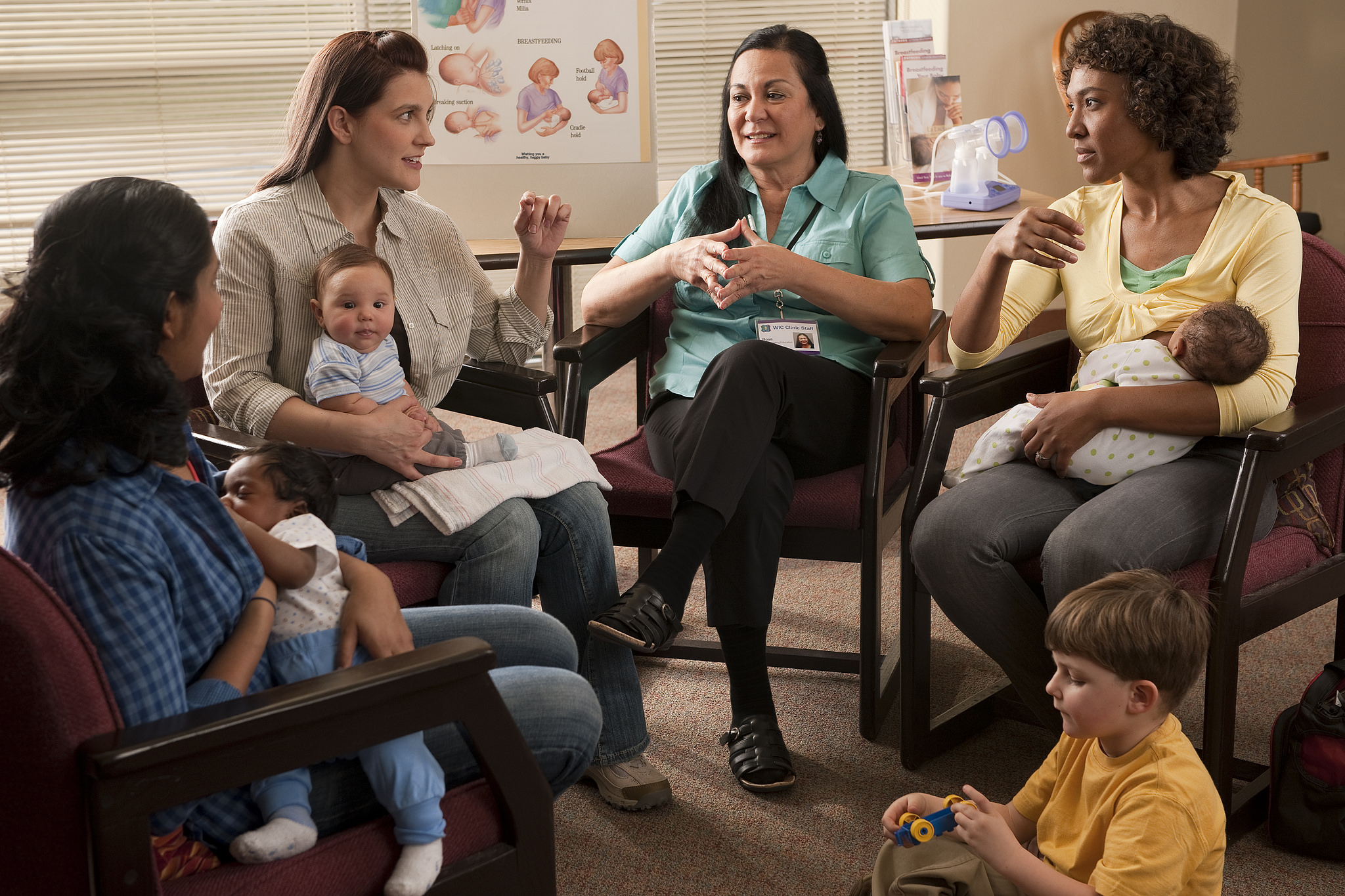 New moms participating in a group discussion