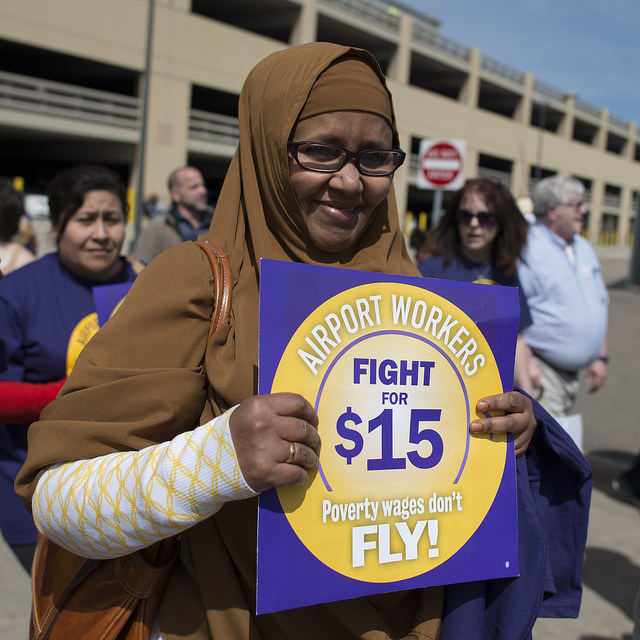 Airport employees protest minimum wage