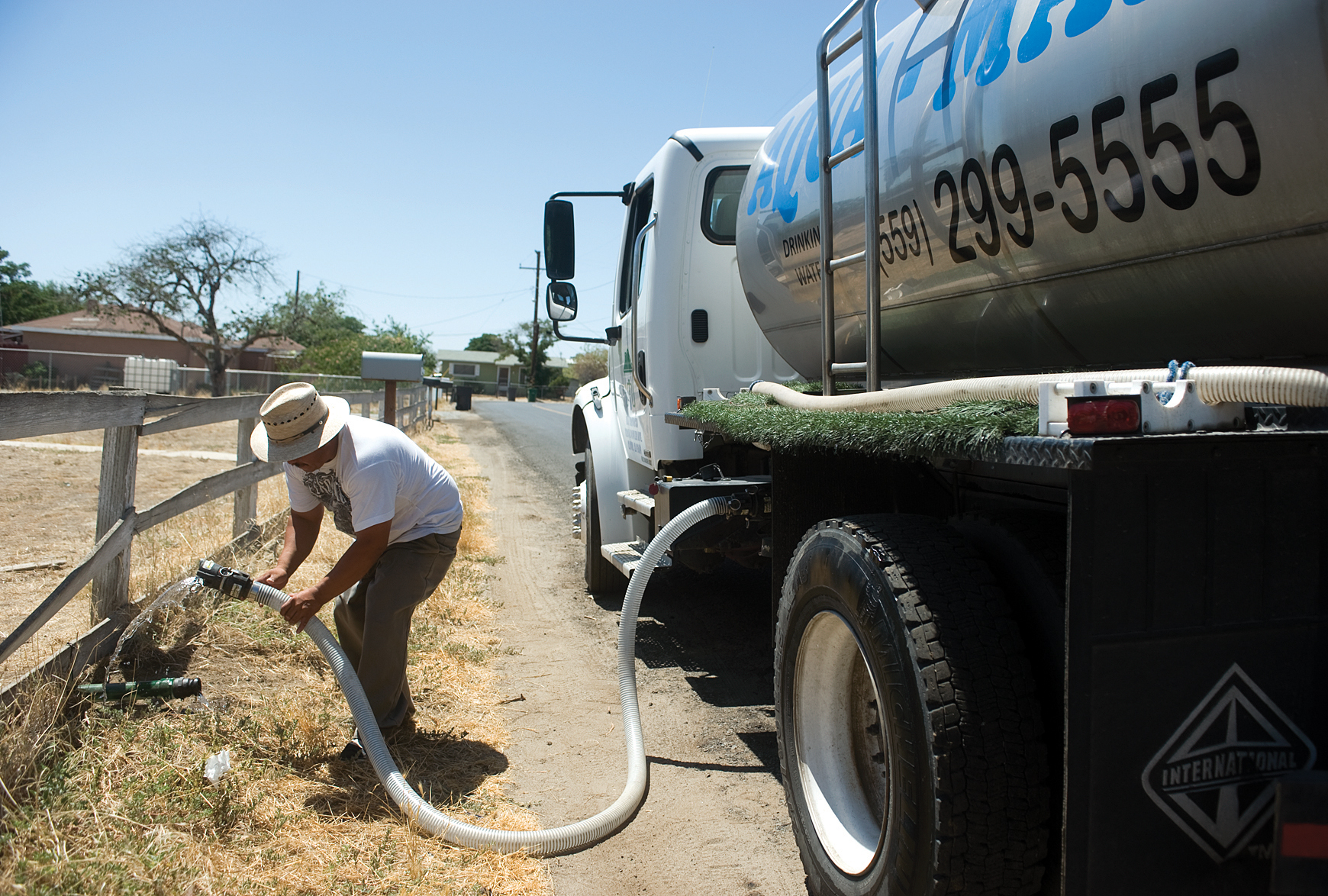 Man uses water truck in East Porterville, California