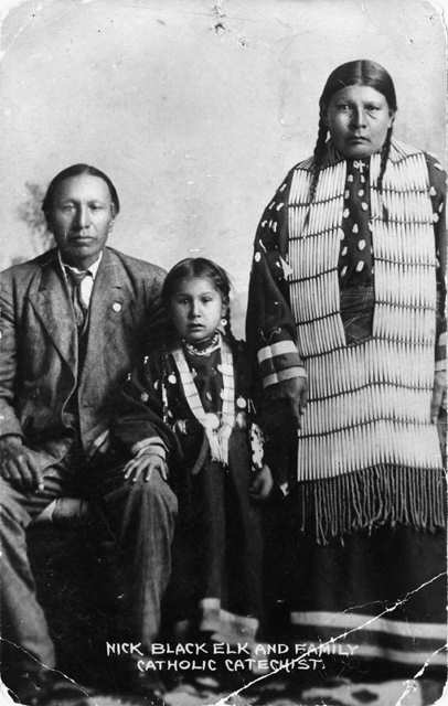"""Nicholas Black Elk, daughter Lucy Black Elk and wife Anna Brings White"" (1910)"