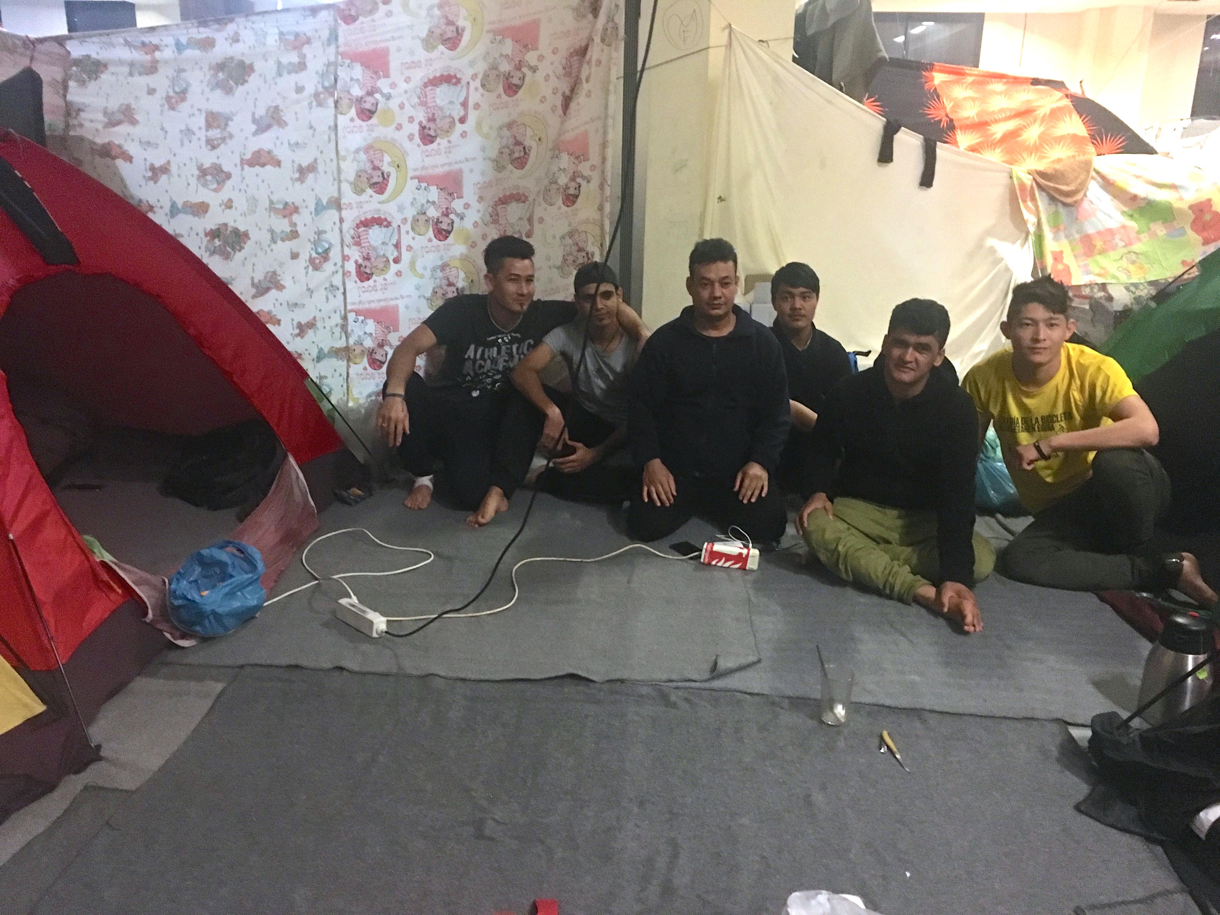 Men gather at Ellinko