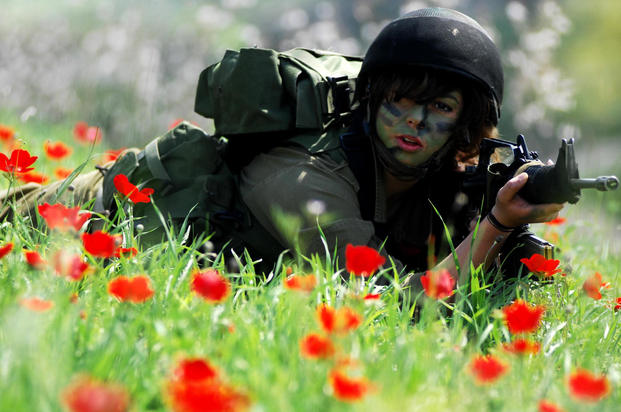 Female Israeli Soldier in a Field of Flowers