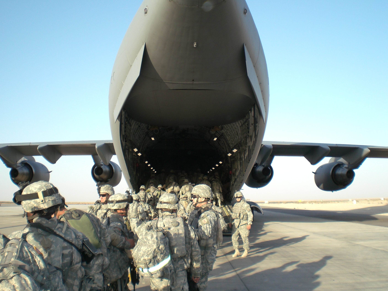 U.S. Army soldiers board a plane to Iraq.
