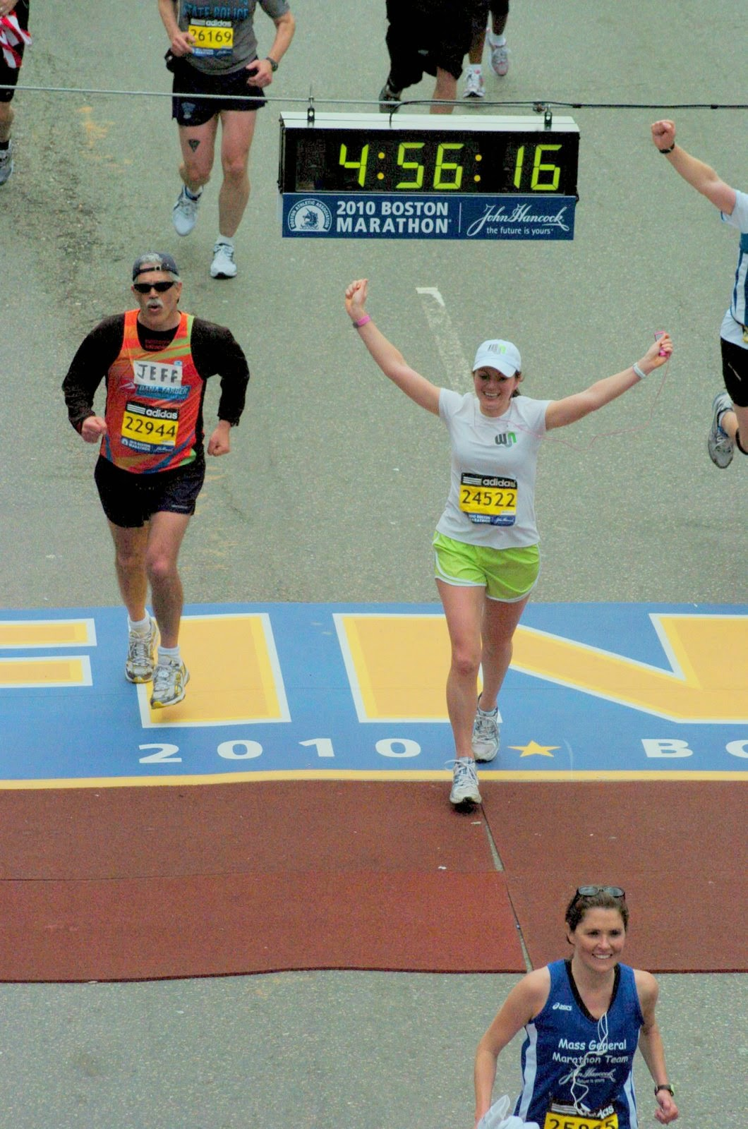 Julie Flygare finishing the Boston Marathon.