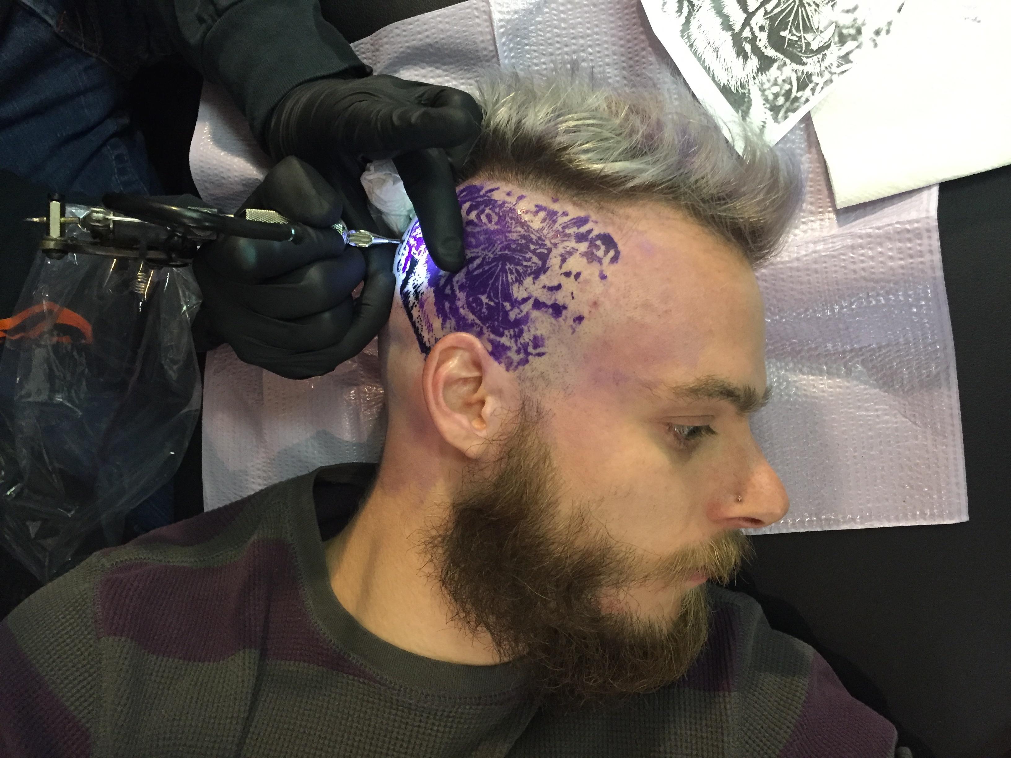 Dean tattooing Herman