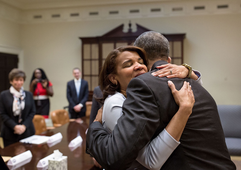 """""""President Barack Obama hugs Kemba Smith during a greet with formerly incarcerated individuals who have received commutations, in the Roosevelt Room of the White House, March 30, 2016."""""""