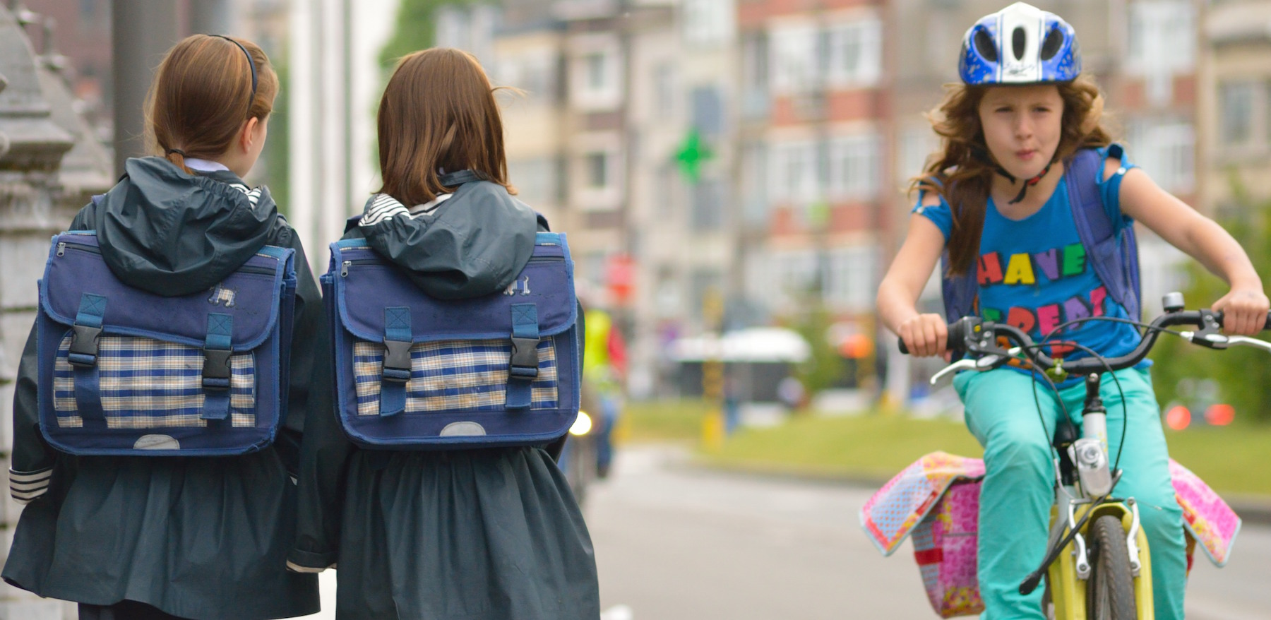 school-uniforms-and-girl-on-colorful-bike