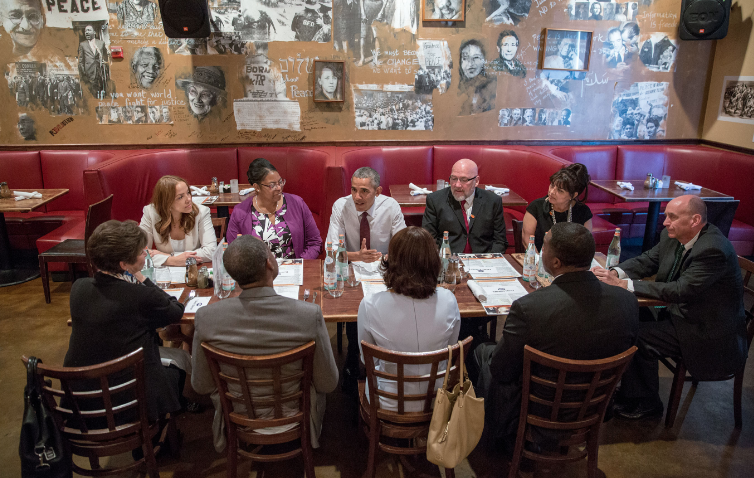"""""""President Barack Obama meets for lunch with formerly incarcerated individuals who have received commutations, at Busboys and Poets in Washington, D.C., March 30, 2016."""""""