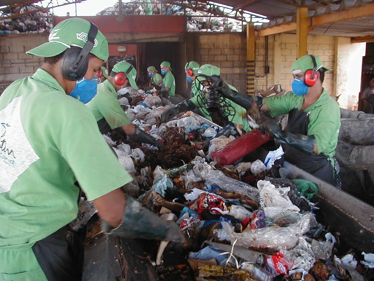 Workers sort through waste