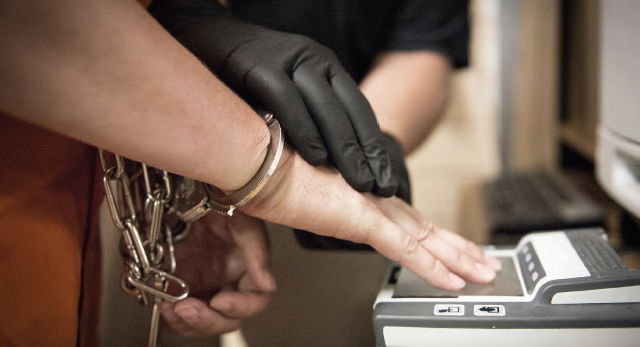 U.S. Marshals fingerprint an inmate.