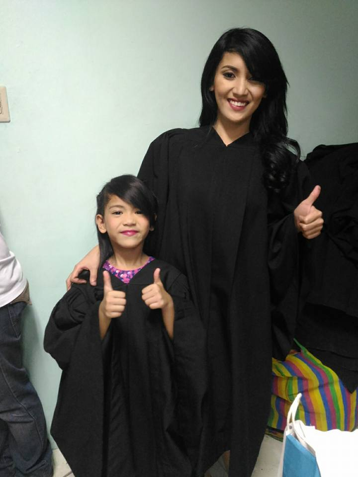 Vin-zl Vicente with daughter in graduation robes