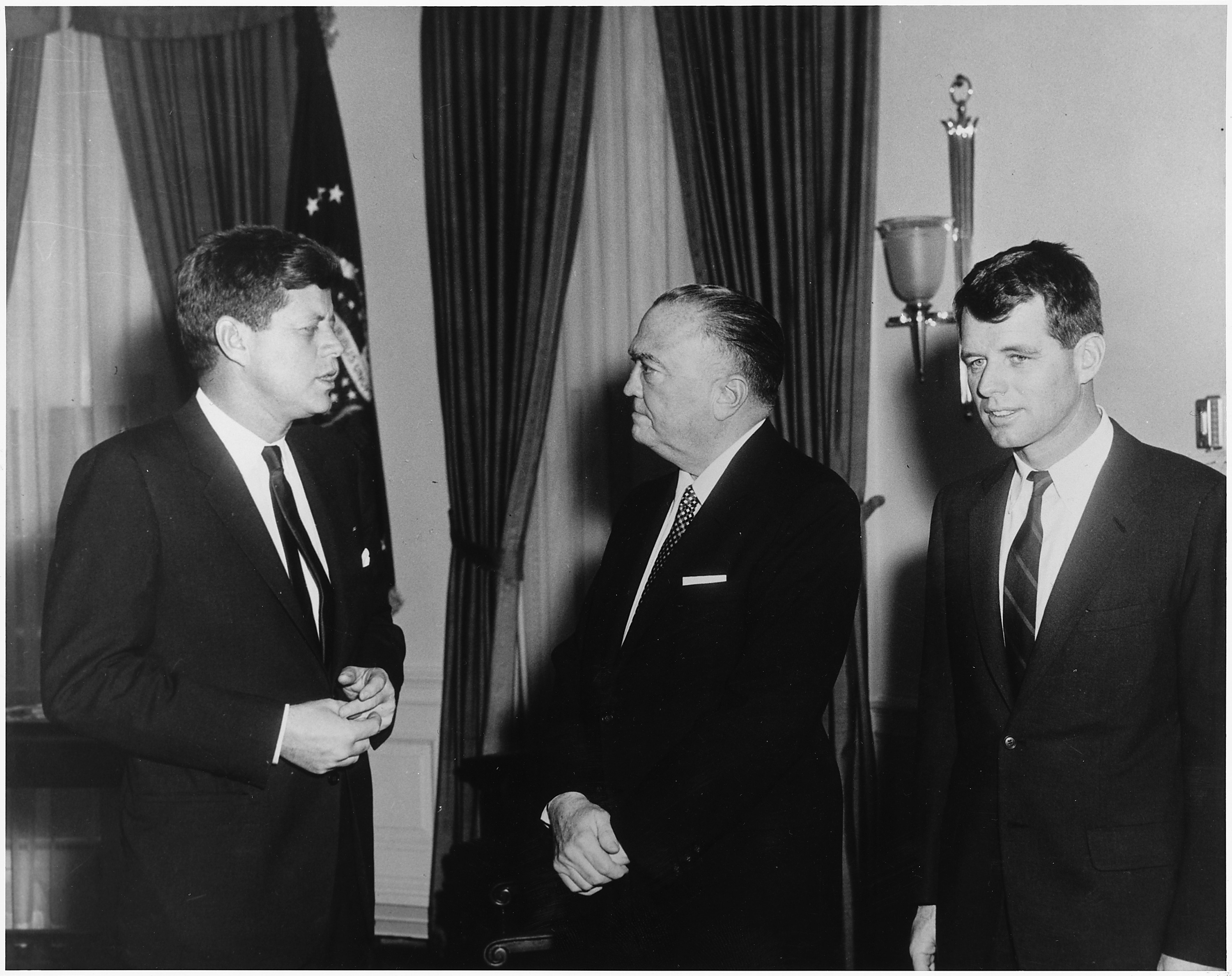 J. Edgar Hoover, pictured in the middle, meets with President John F. Kennedy on the left and Attorney General Bobby Kennedy on the right in 1961.