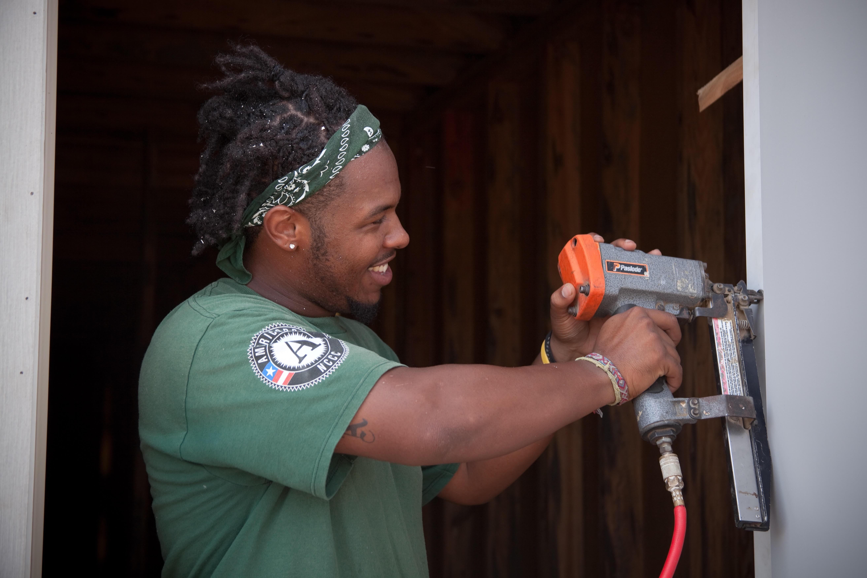 Service Year volunteer doing construction