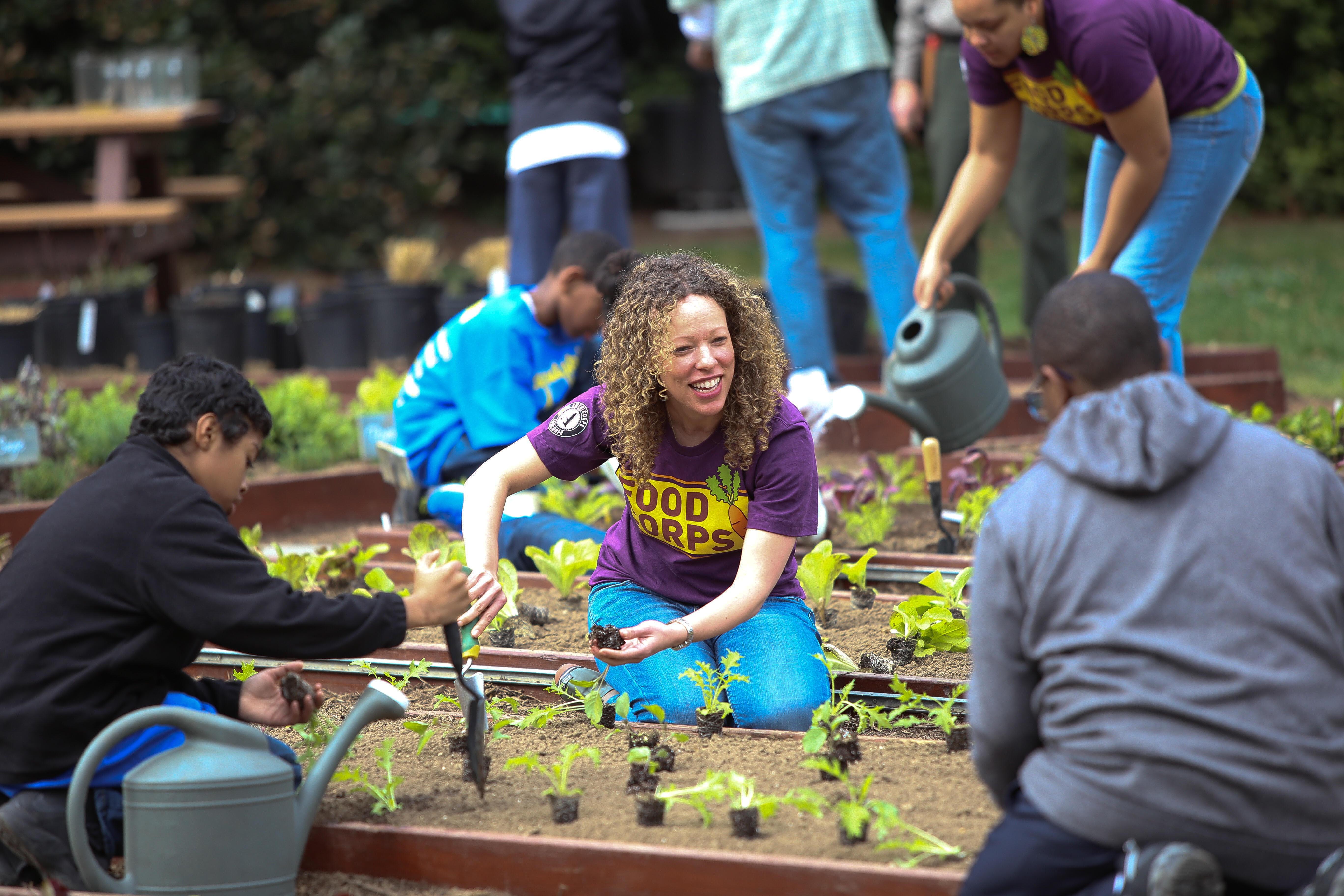 Americorps volunteer in a garden