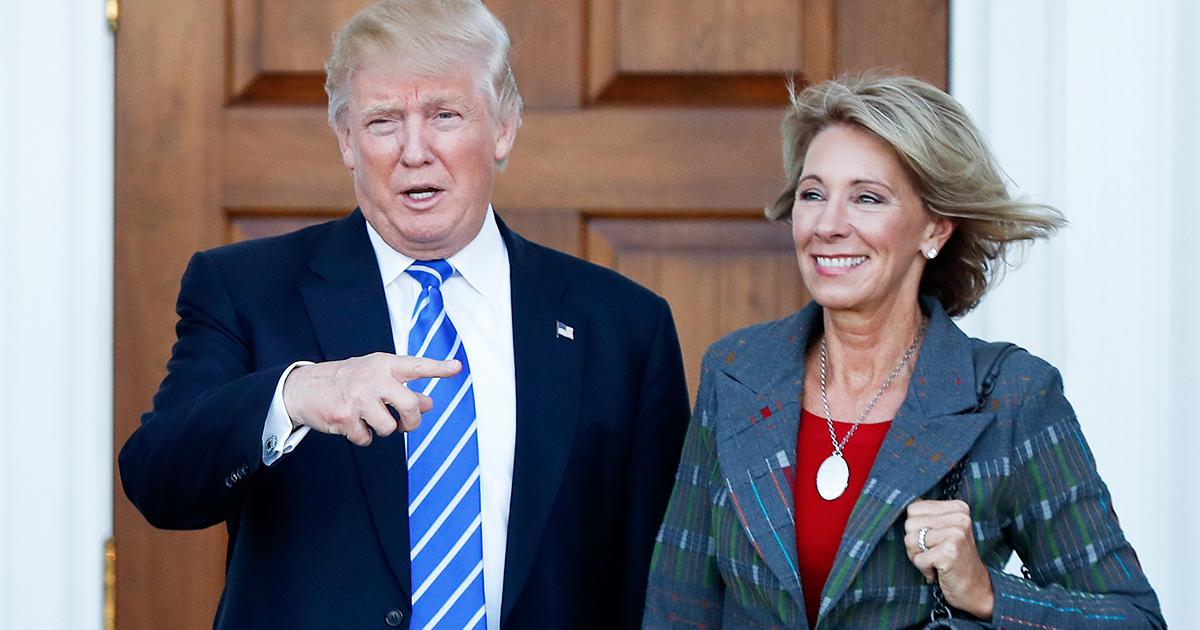President-elect Donald Trump and Betsy DeVos.