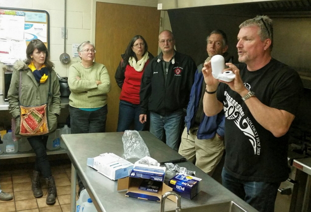 Crossing Water volunteer giving a demonstration on filter use.