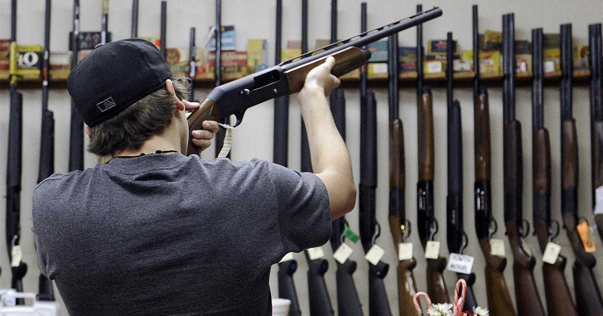 man-looking-at-gun-in-gun-store