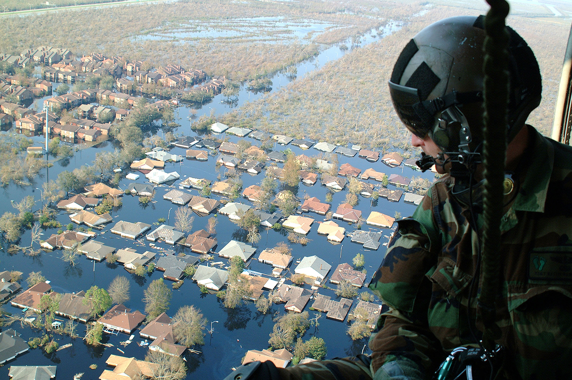 The U.S. Airforce flies over flooded neighborhoods after Hurricane Katrina.