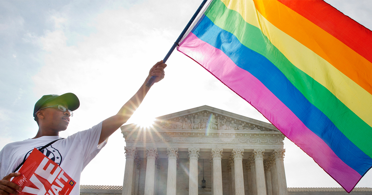 man-waving-rainbow-flag-in-support-gay-marriage