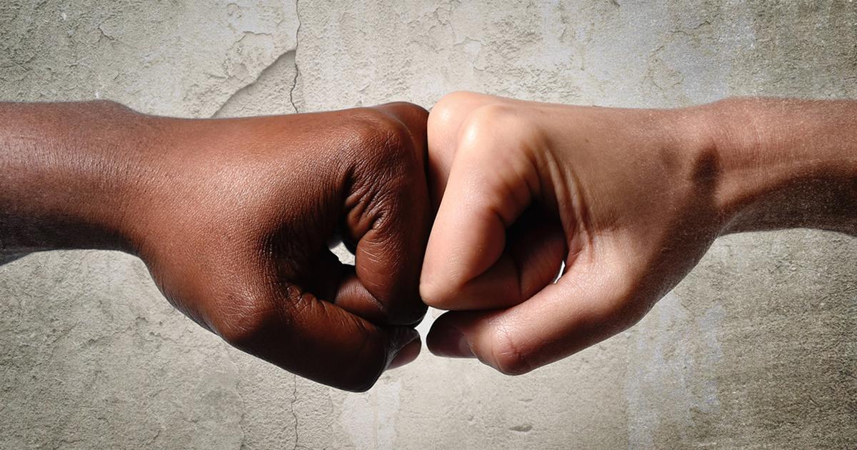 black-skinned-knuckles-pounding-white-skinned-knuckles