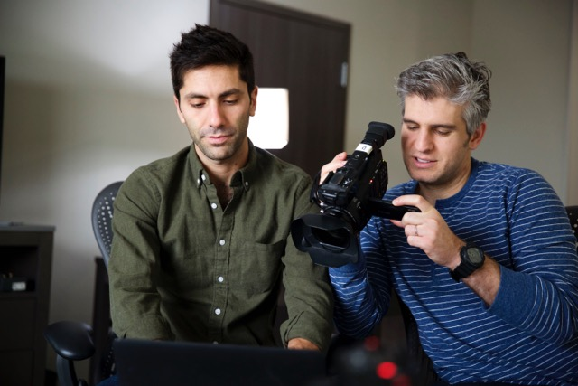 Nev Schulman looking at his computer
